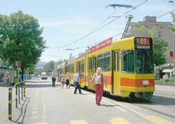 Light rail / trams / streetcars calling at stops located within the street environment.