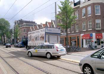 Vehicles briefly straying on to light rail reserved right of way in Amsterdam.
