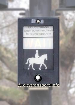 Pegasus crossing 'call' pushbutton unit with a pictogram of a horse and rider.
