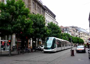 Light rail travelling through city street in Strasbourg.