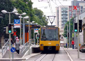 Heavy rail style fully tensioned catenary in the street domain.