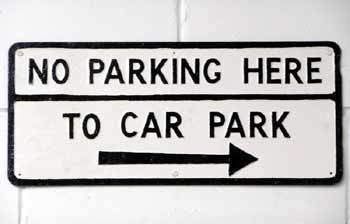 'No parking' sign also points towards where parking is allowed.