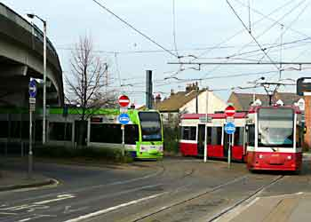 Tramlink trams in new and old livery