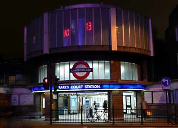 Nocturnal illumination of Warwick Road Entrance Earls Court station.