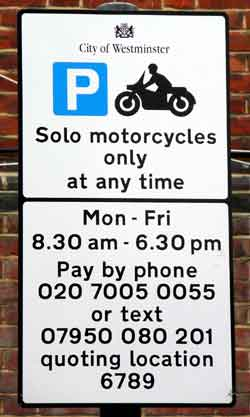 Sign saying that parking motorcycles here is chargeable.