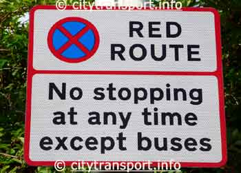 Red Route 'No stopping at any time except buses' sign.