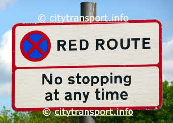 Red Route 'No stopping at any time' sign.