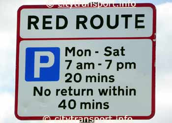 Red Route road sign for a section of road where free parking is allowed.
