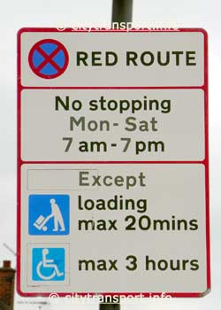 Red route sign for combined loading bay / disabled parking space.