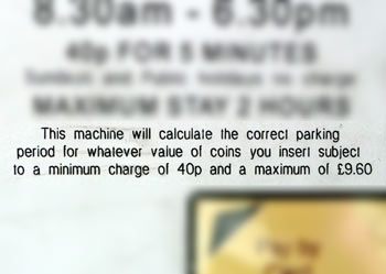 Close up of information about how the machine will calculate correct parking period according to funds inserted..