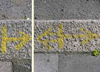 Markings on kerbstone as described in image caption.
