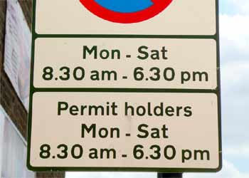 Lower part of sign at start of combined pay and display plus 'permit holders' parking area.