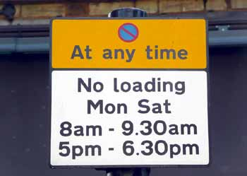 Sign shows that parking is prohibited at all times whilst loading allowed outside the rush hours.