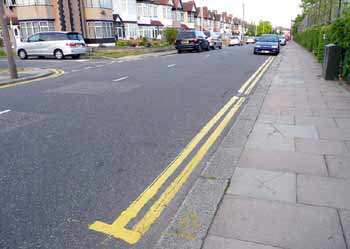 Road with new yellow lines and no traffic congestion.