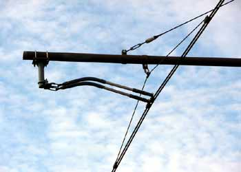 Close up of street based light rail / tram / streetcar overhead wires.