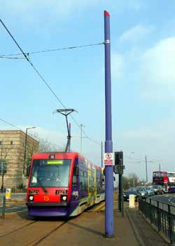 Light rail / tram / streetcar overhead wire supported from circular poles.