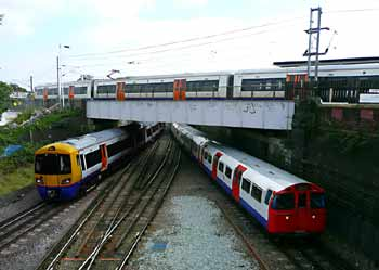 Overground Underground trains at Willesden Junction.
