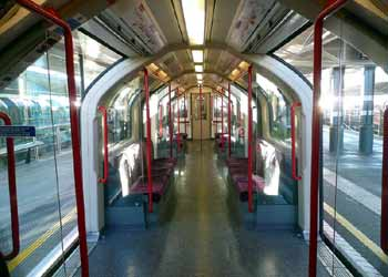Stratford station train with doors open on both sides.