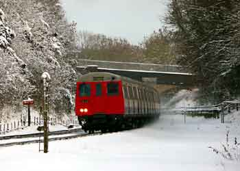 A stock train as seen from Chorleywood station car park.