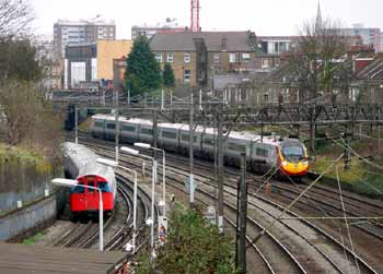 Route sharing Bakerloo Line and Virgin Pendolino Tilting Train At Kensal Green.