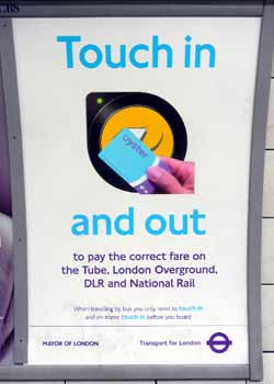 Poster reminding passengers to touch in and out.