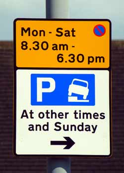 End of permitted to park with one side of vehicle on kerb road sign.