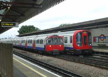 District and Piccadilly Line trains at Stamford Brook station.