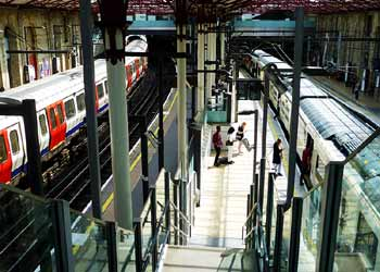 Thameslink and London Underground trains at Farringdon station London.