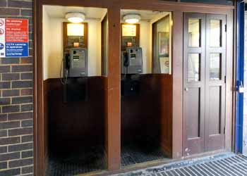 Telephones booths at Arnos Grove station.