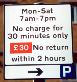 Sign gives 30 minutes free parking Monday - Saturday 7am-7pm, with £30 fine for coming back within 2 hours.