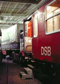 A Danish railway carriage and a juggernaut sharing one of a ferry's heavy-vehicle decks.