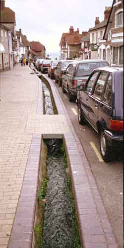 A water channel located along the kerb.