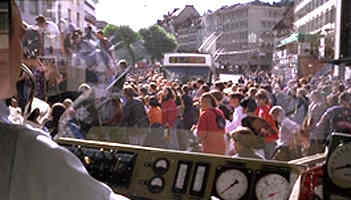 Swiss youngsters in St Gallen delay light tail and trolleybus services by dancing on a very slowly moving van.