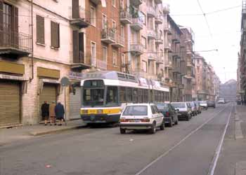 Italian style parking on a road also used by trams.
