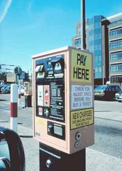 Pay and display machine requiring motorists to pay on entrance to car park.
