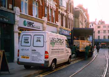 Delivery vehicles parked partly on footpath violating 'swept path' of tramline.