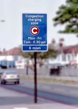 Congestion charge advance warning sign.