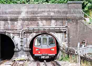 A tube train at a tunnel mouth.