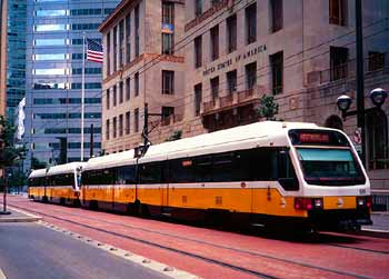 Light rail travelling through city street in Dallas.