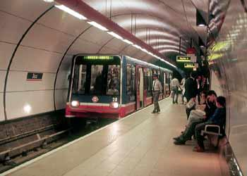 DLR train in platform at the subterranean Bank Station.