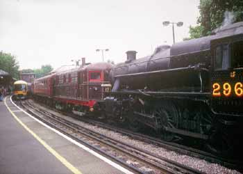 Train pulled by a Steam locomotive and Sarah Siddons electric engine pass a Chiltern 165 DMU during Steam On The Met.