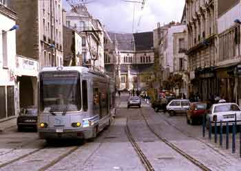 A tram glides along a 'traffic calmed' street in Paris.