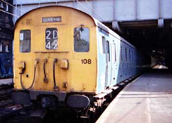 The front of a Class 307 train at London Liverpool Street Station.