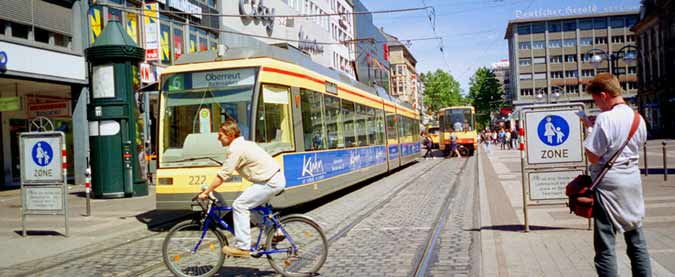Trams, cyclists and pedestrians in Karslruhe city centre.