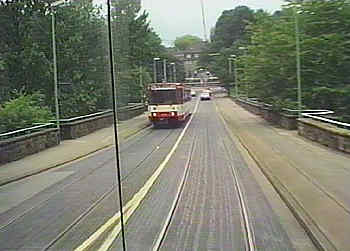 LRV is sharing roadway over bridge with general traffic.