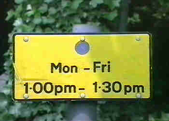 Road sign bans parking between 1pm and 1.30pm.