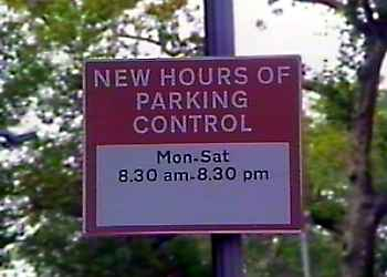 Sign advising that controlled parking hours have been changed.