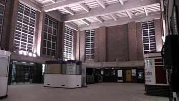 Inside Oakwood station ticket hall at night.