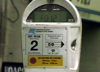 A parking meter, complete with warnings that it is only to be used 'off peak'.