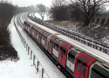tube train electric rail snow sparks.